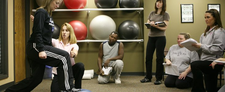 Fitness Training Students learning proper movement techniques at WellSpring