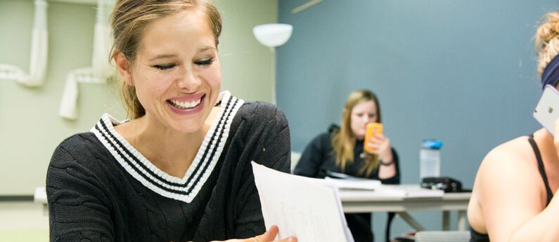 Close-up of Continuing Ed Students in a classroom, smiling.
