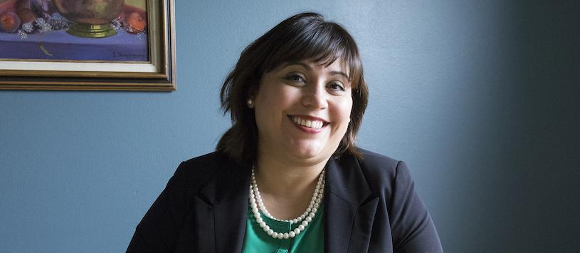 A smiling admissions advisor
