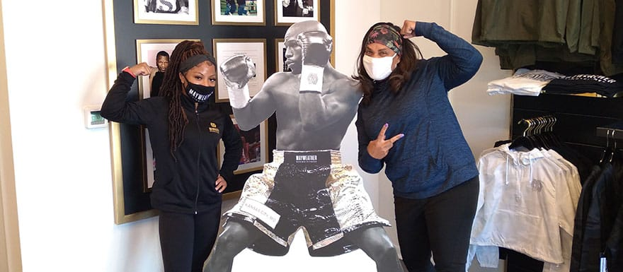 WellSpring students posing in front of a Floyd Mayweather cardboard cut-out.