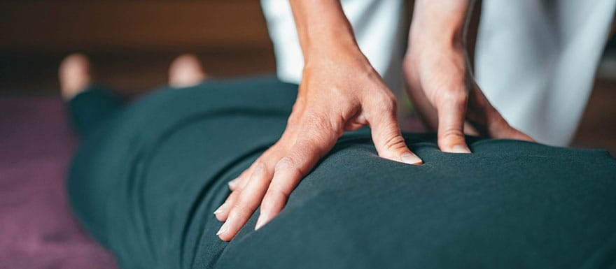 Client is receives a back massage from a Massage Therapist.